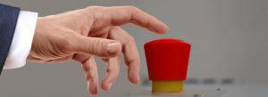 Finger hovering over red button trigger