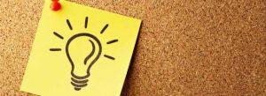 Ideas lightbulb drawn on post-it note