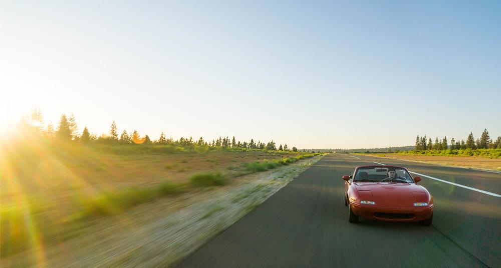 MX5 driving along road