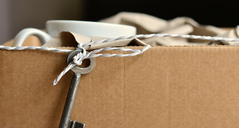 Moving cardboard box with key