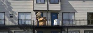 Moving boxes outside house