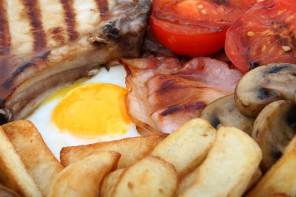 Eggs Bacon Chips and Sausage breakfast