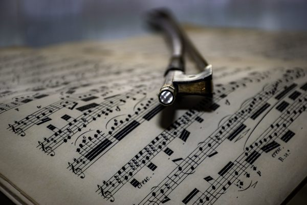 Violin bow resting on sheet music