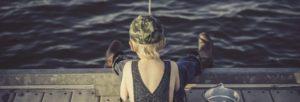 Boy fishing on wharf - trimmed
