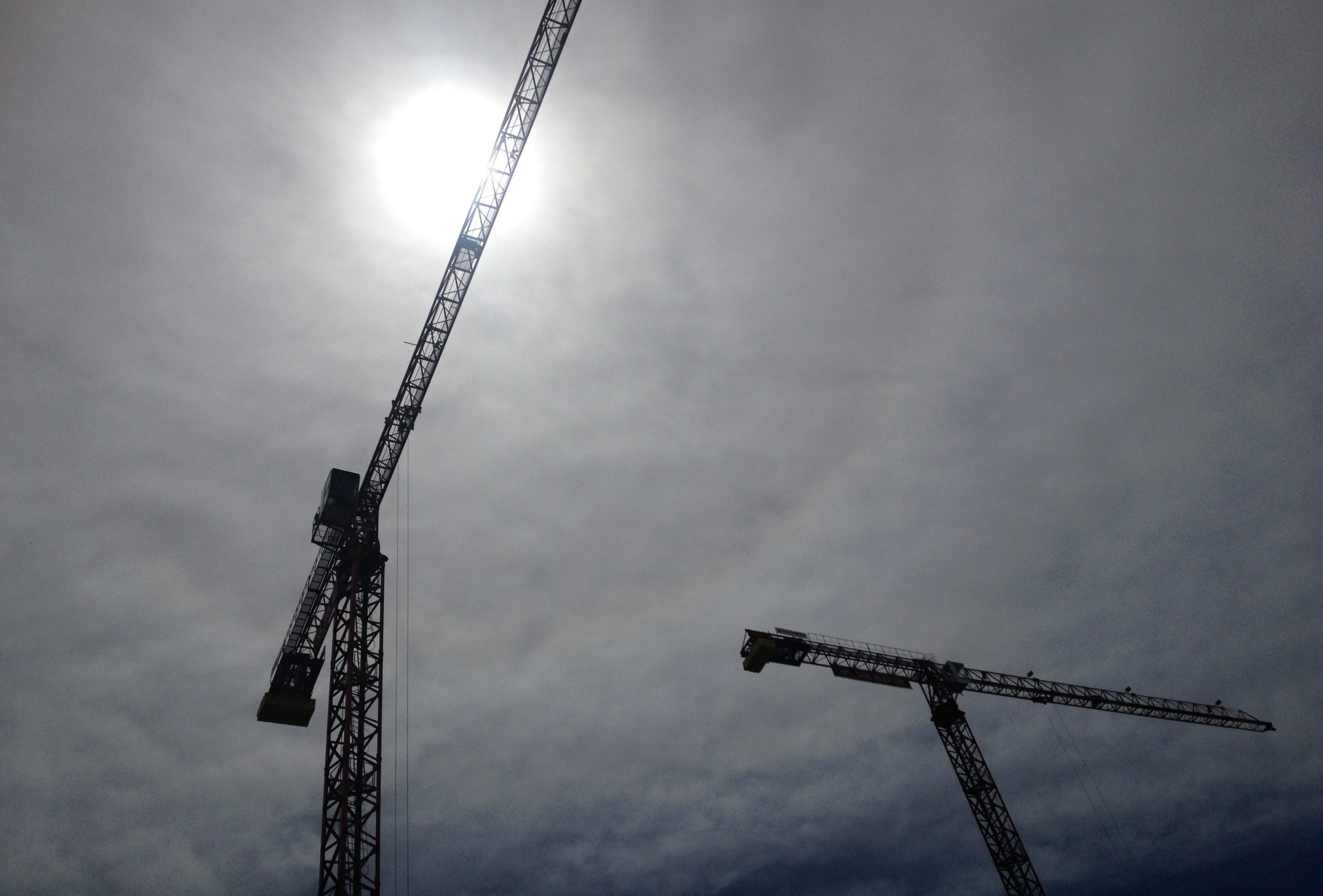 Construction cranes against the sky