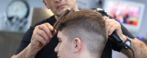Young man having haircut at barber