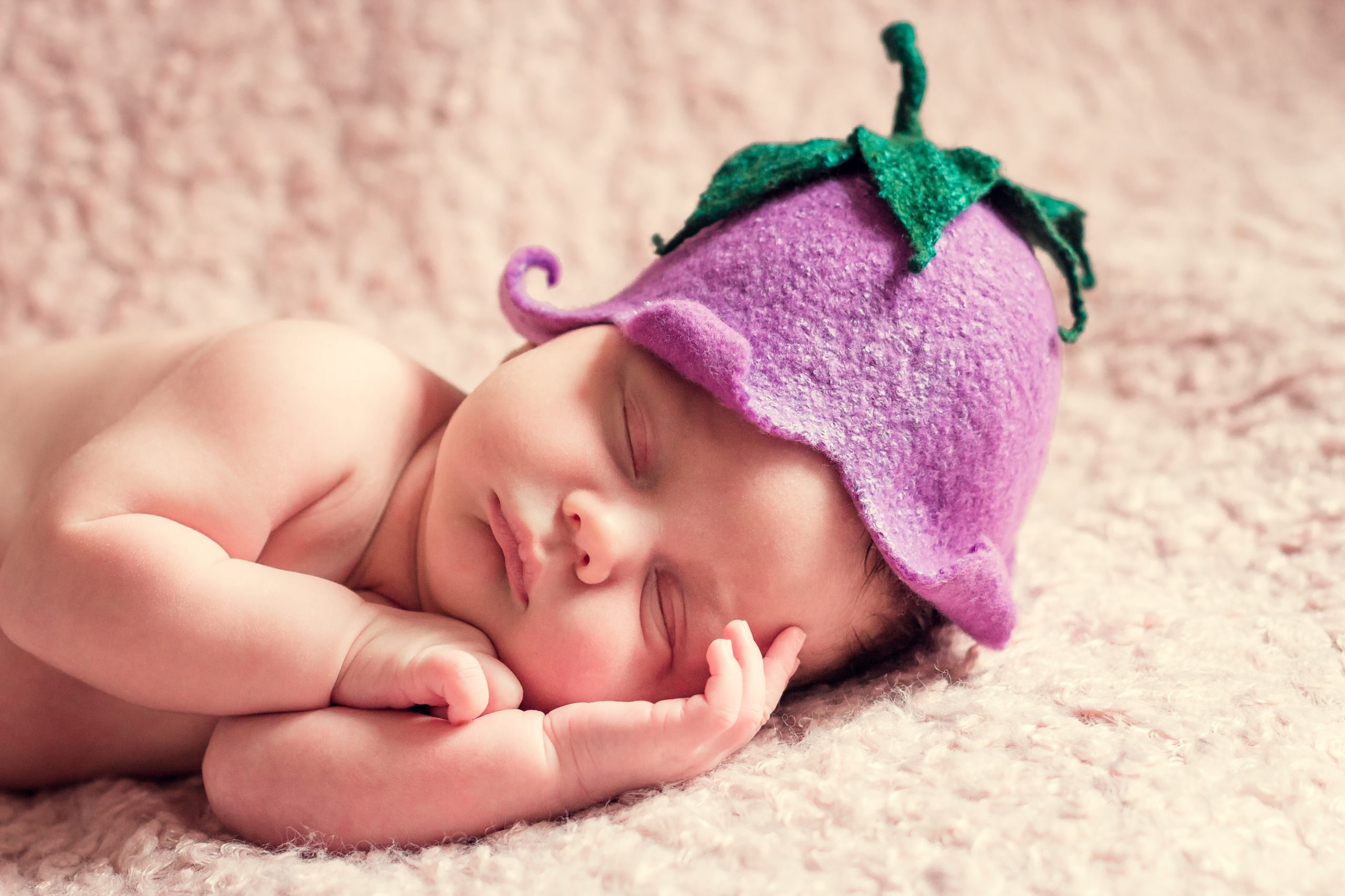Cute baby asleep with funny hat on