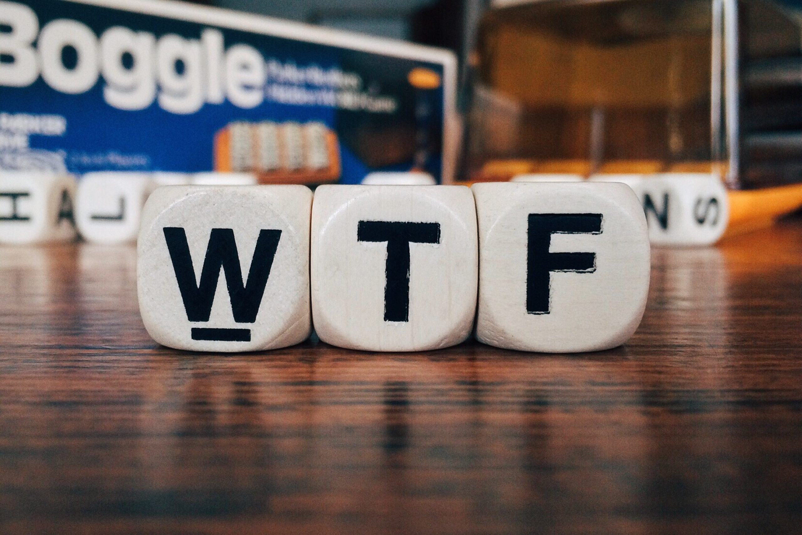 The letters W, T and F on a set of white dice